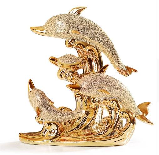Estatua de delfines de porcelana